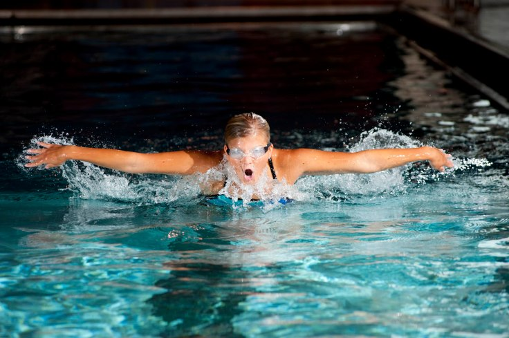 Campus Rec student swimming butterfly in pool Club sport group Bill 7_21_09